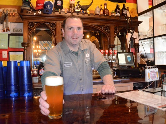Charles Grantier serves a beer at Territorial Brewing